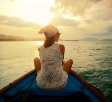 woman-traveling-by-boat-at-sunset-among-the-islands-881x588